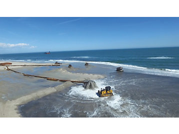 Dredging and natural infrastructure restoration work by Caterpillar customer Great Lakes Dredge & Dock.