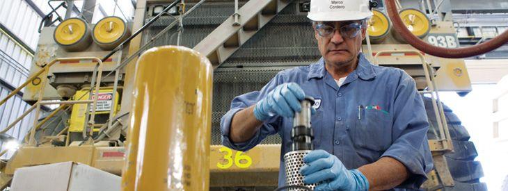 A Preventive Maintenance (PM) technician inspects a transmission screen in the Sierrita mine shop