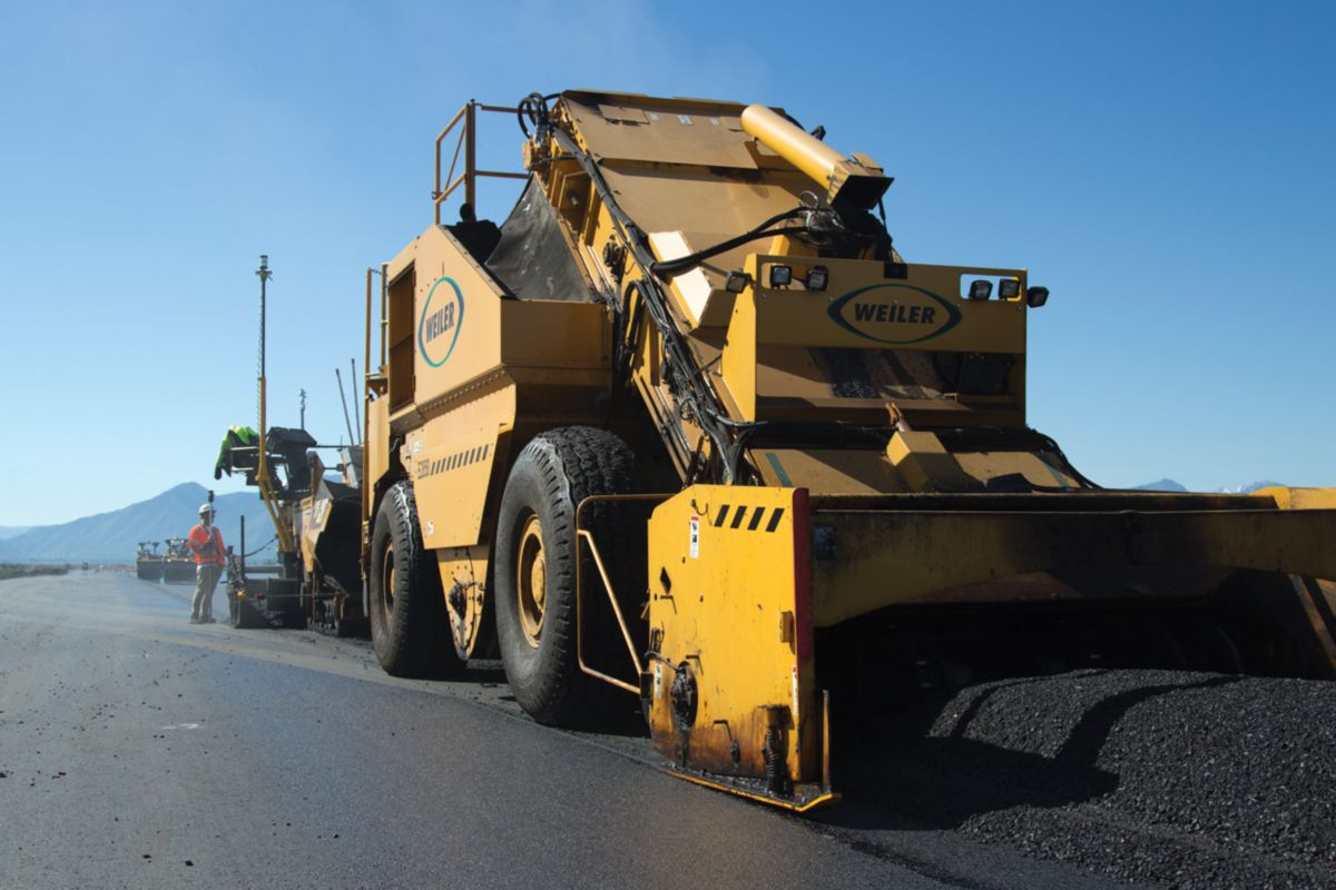Two Weiler E2850 Remixing Transfer Vehicles (RTVs) were paired with the Cat pavers to ensure smooth, consistent paving.