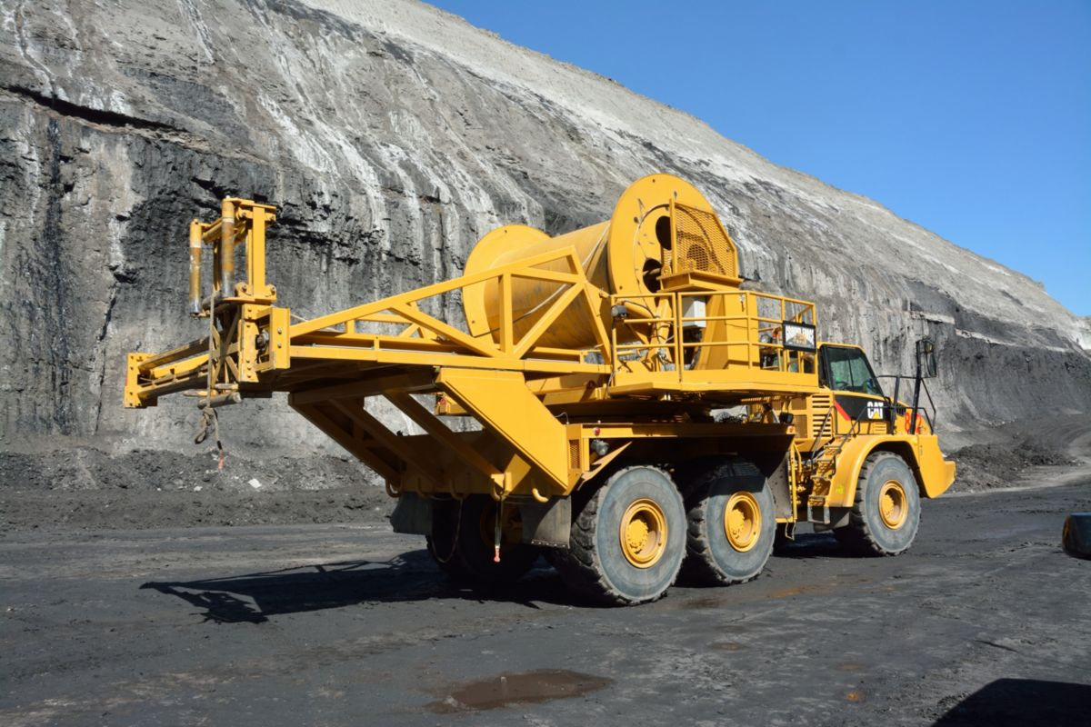 Powering the mine's draglines and mining shovels is fast and simple with the highly efficient and maneuverable Ground Force Cable Reel Trucks that combine a Ground Force cable reel system with a specially modified Cat 740B Articulated Truck.