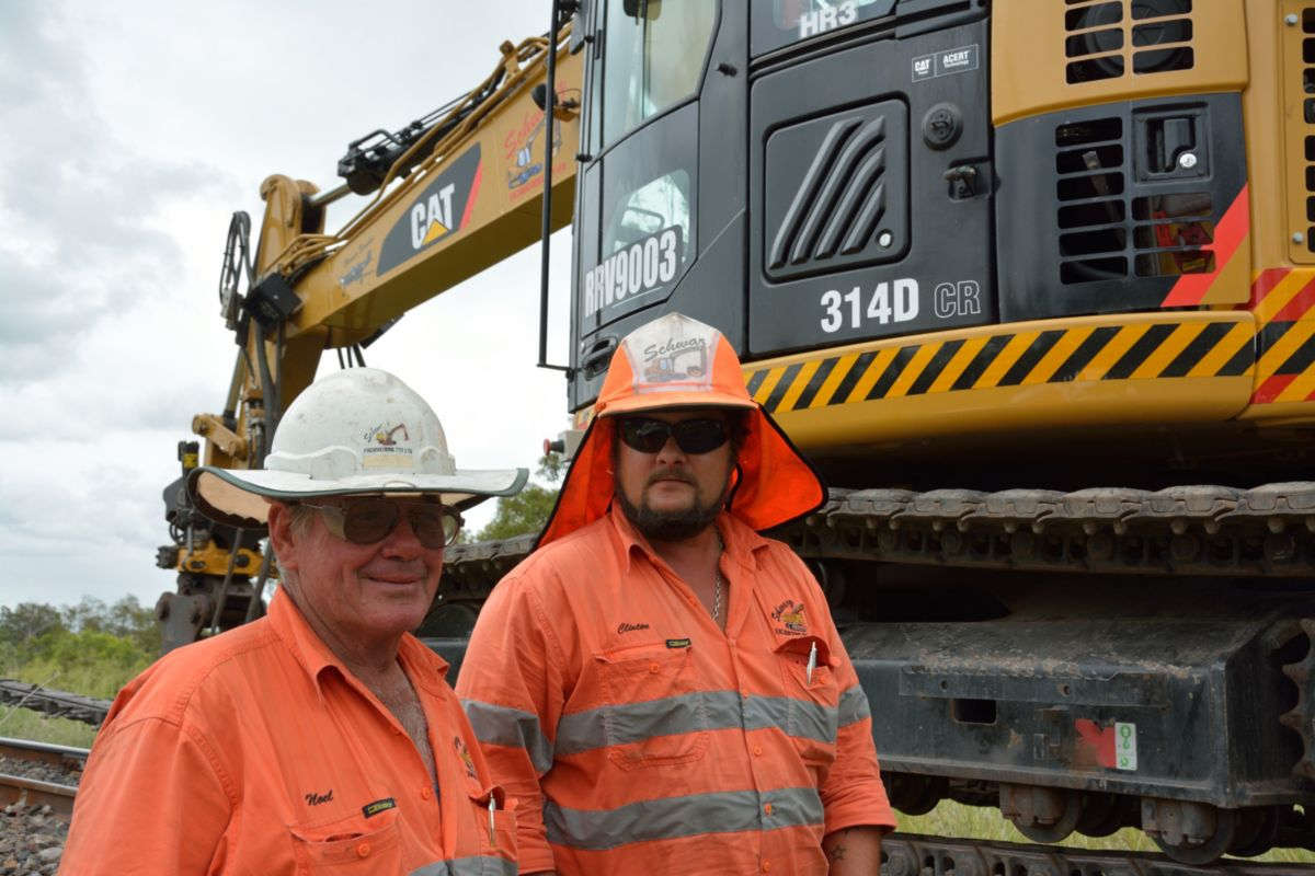 Noel Schwarz, Managing Director of Schwarz Excavations PTY LTD, stands with a machine operator in from of one their RMT14Ds.