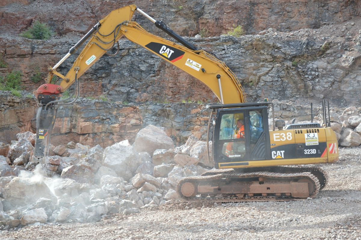 KJ Services Ltd recently purchased the new Cat® H130Es hammer primarily for its 323D excavator, which it's using to break up limestone for a quarry customer.