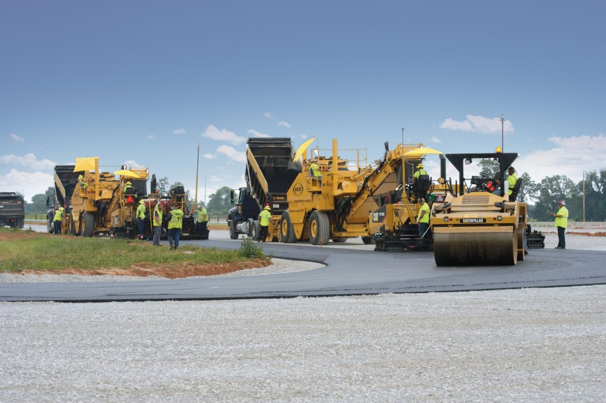 The paving train moved continuously to help achieve smoothness targets.