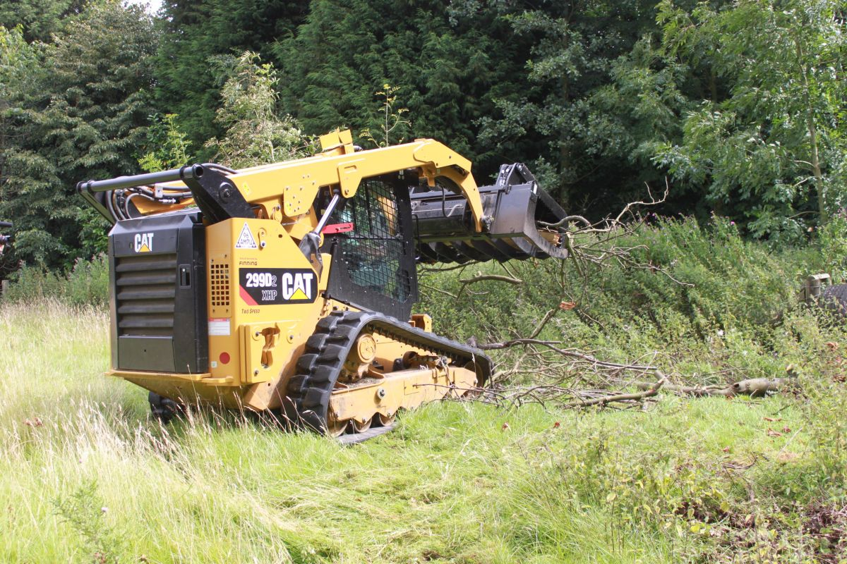 """I saw the 299D2 XHP as a tool carrier, plain and simple. We saw it as having great capacity, because of the range of tools that we could put on it – in addition to those we needed for the forestry."" – Charles Wake"