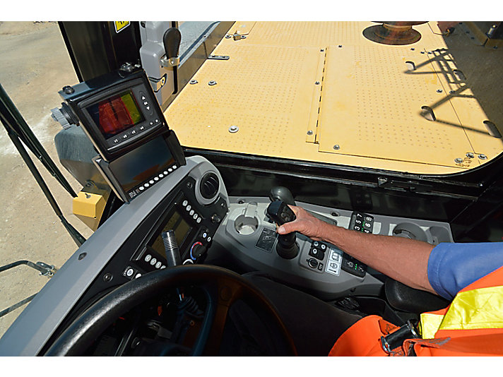 Operator using the Cat Water Delivery System integrated cab controls and electronics in a water truck at the Tuscon Proving Ground (TPG)
