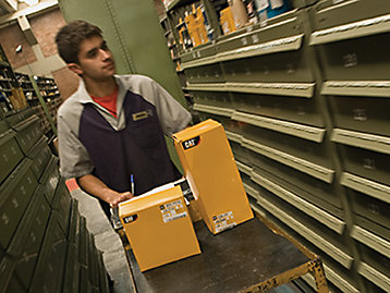 Cat distribution center employee locating parts in the warehouse