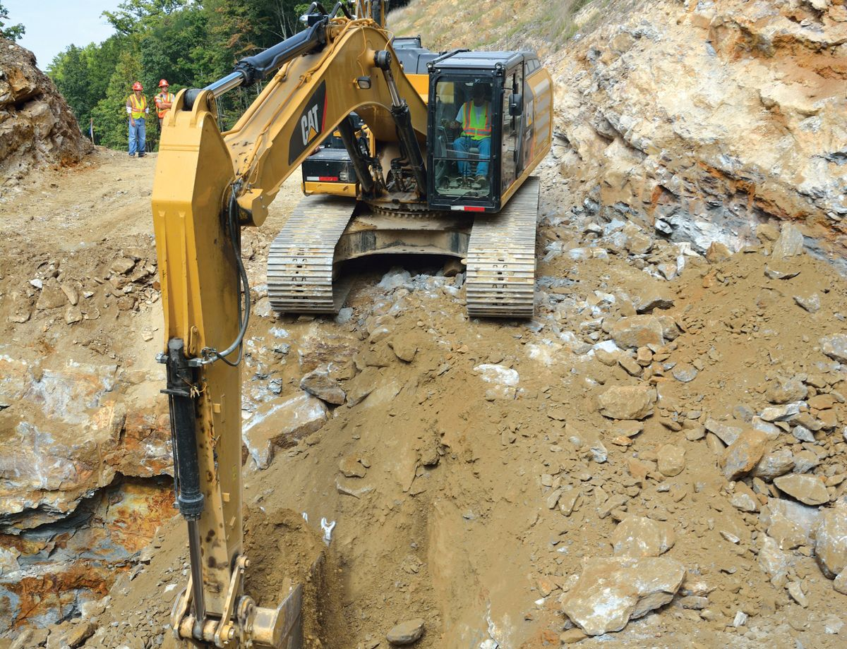 Four Cat 336E Hydraulic Excavators play key roles in carving out the right of way.