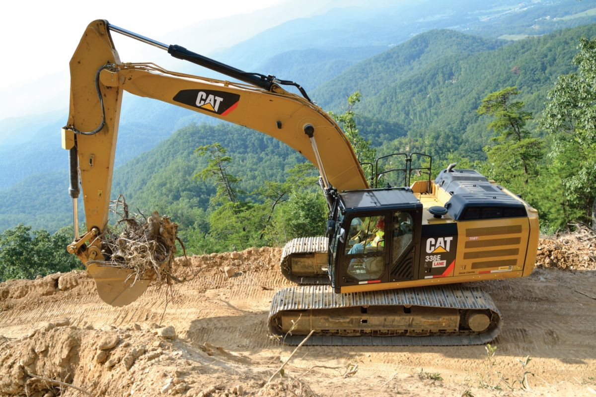 Lane Construction uses Cat® equipment to complete the challenging task of pioneering a road on the side of a mountain.
