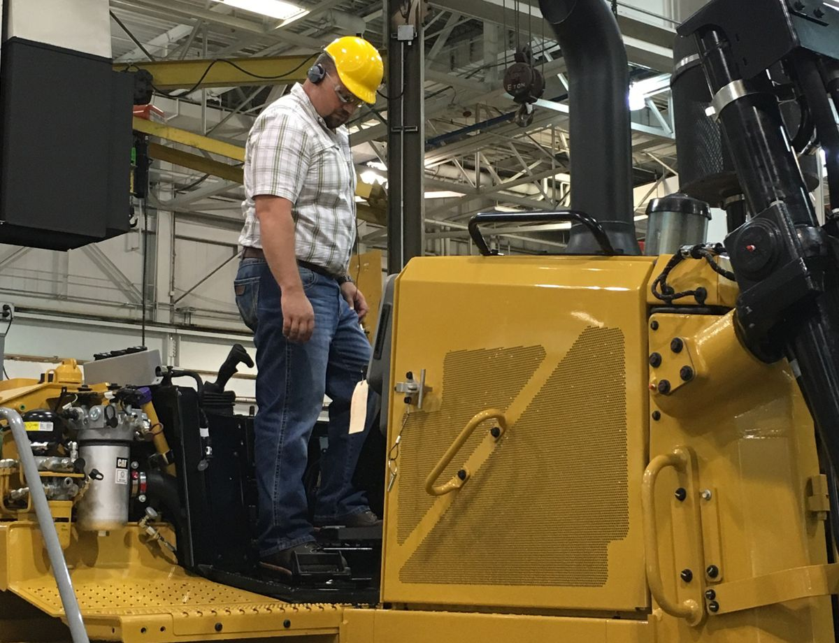 Levi Higdon, Regional Manager for Santek Environmental, got to start up Santek's new Cat® D6T on the tour.