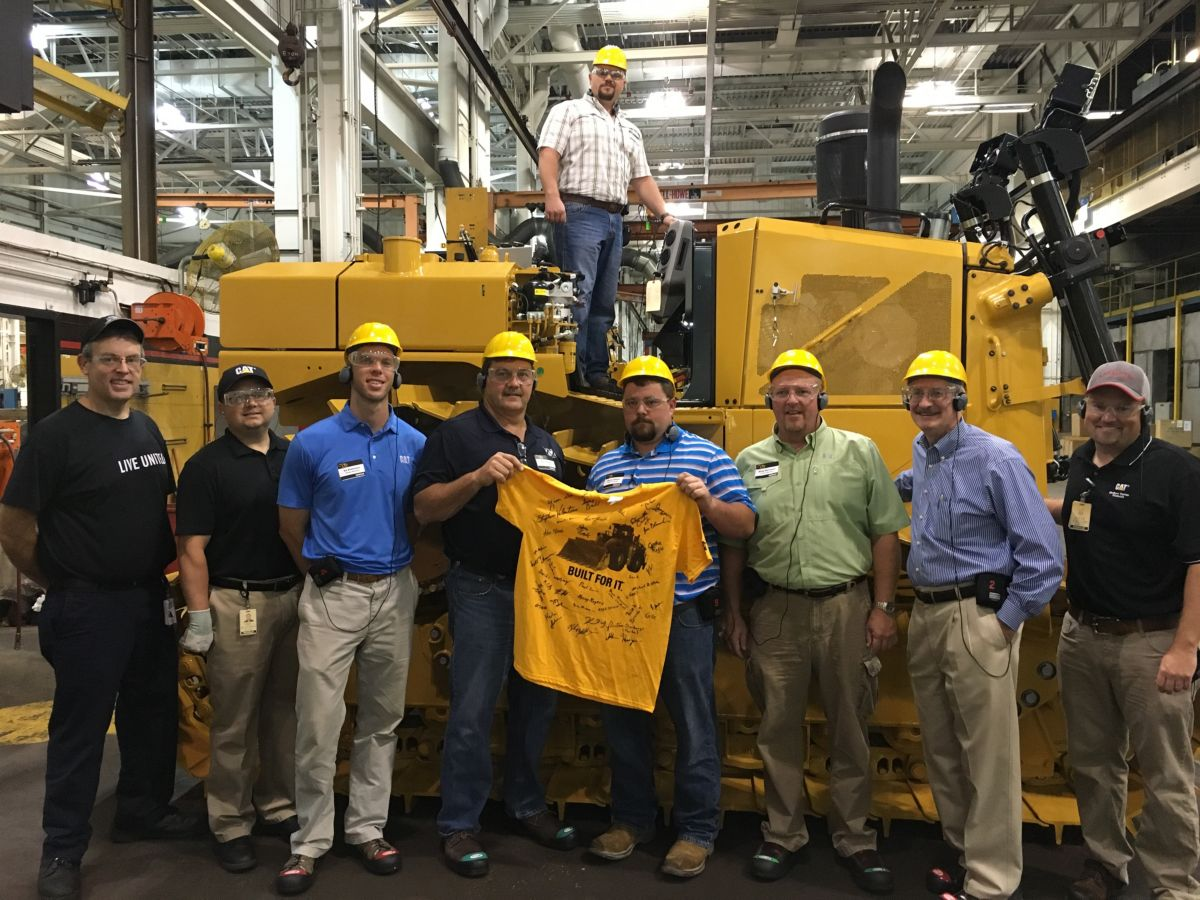 Santek's employees received a T-shirt signed by Caterpillar employees who helped build the company's new D6T at the East Peoria Dozer facility.