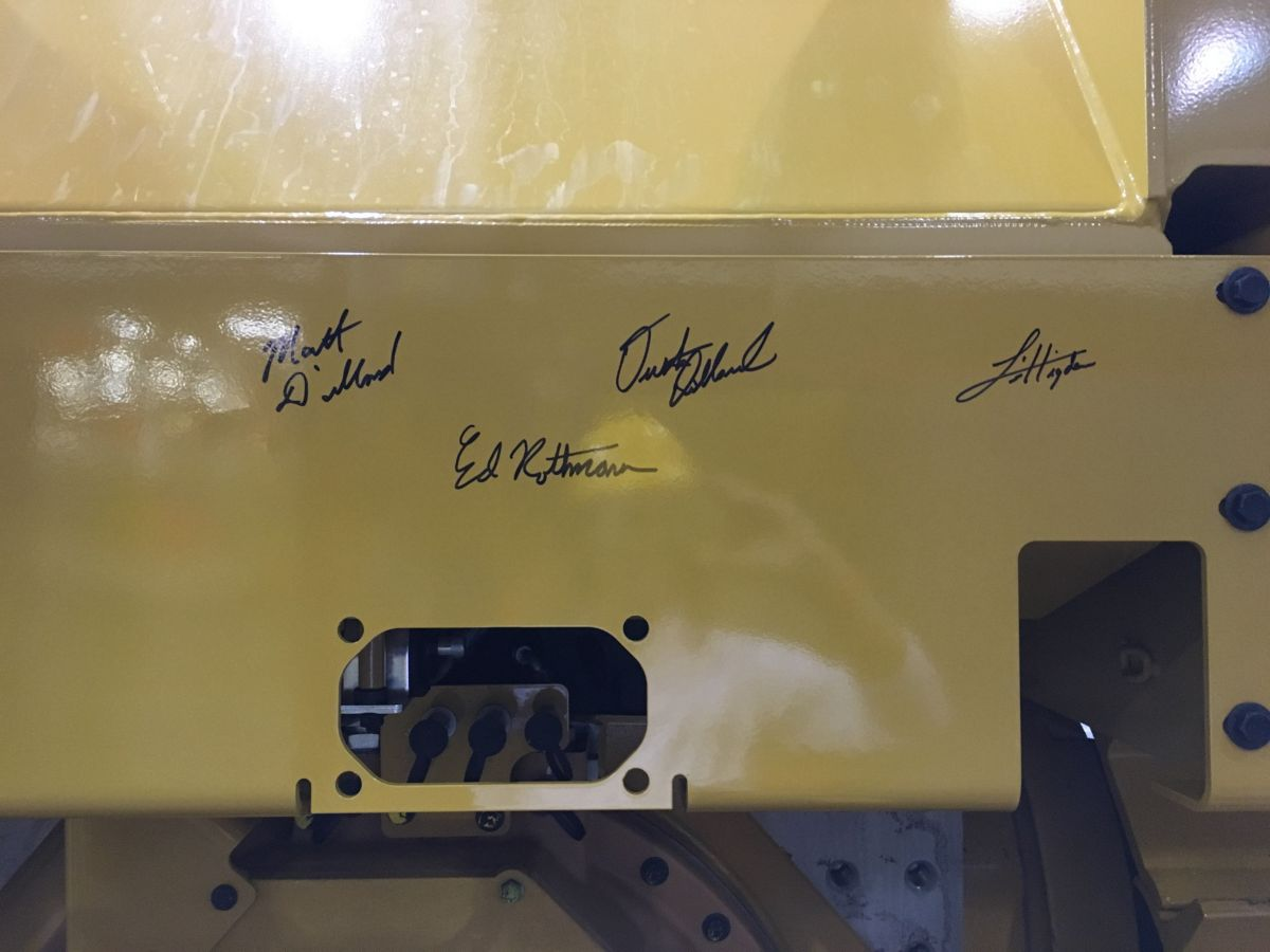 Santek employees commemorated the occasion by signing the D6T that will eventually be added to their fleet.