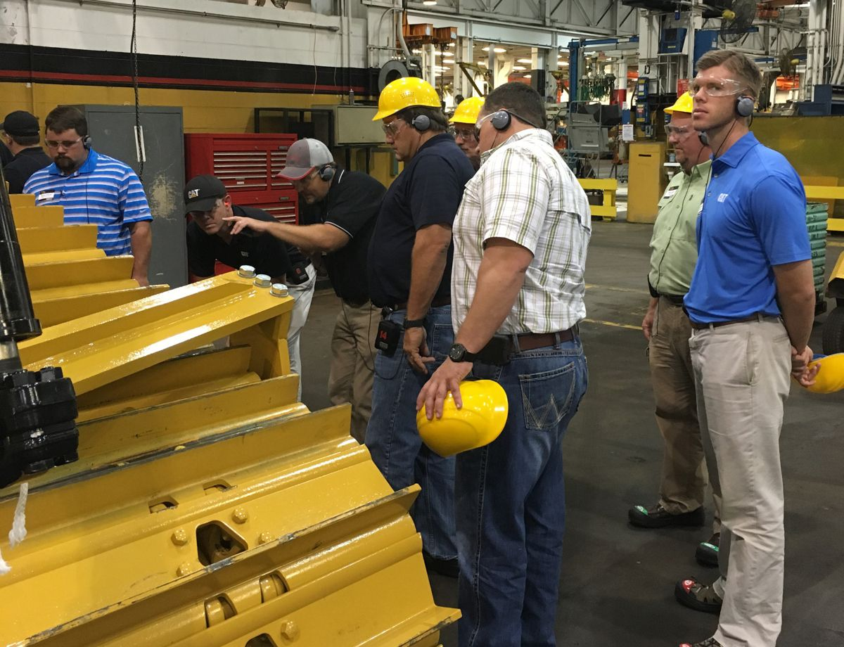 Santek Environmental employees tour the Caterpillar East Peoria dozer facility.