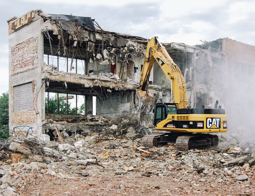 Adamo Group uses bigger iron, like the 345C hydraulic excavator, to tear down large structures safely and efficiently.