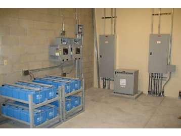 In addition to multiple breaker configurations, this photo shows redundant dual 125 V dc battery systems, each sized to operate the paralleling system for at least 3 hours.