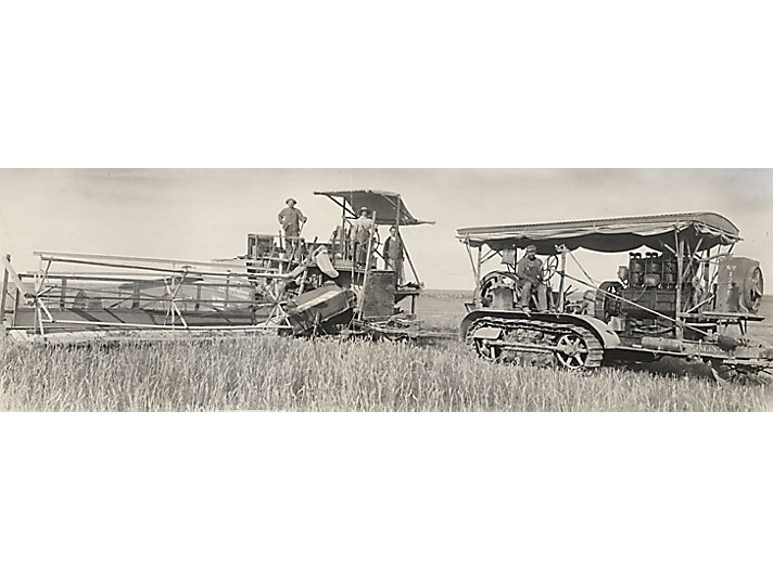 Holt Caterpillar 60 tractor pulling a combine in Australia circa 1913.