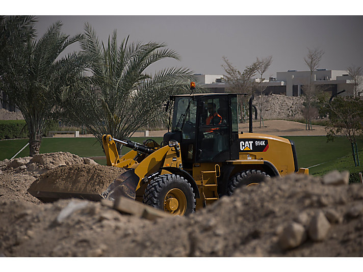 914K Compact Wheel Loader doing site prep work in Dubai.