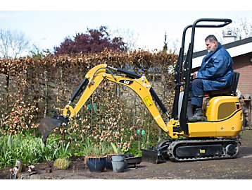 Mini Excavator Relieves Physical Demands of the Job for Landscaper