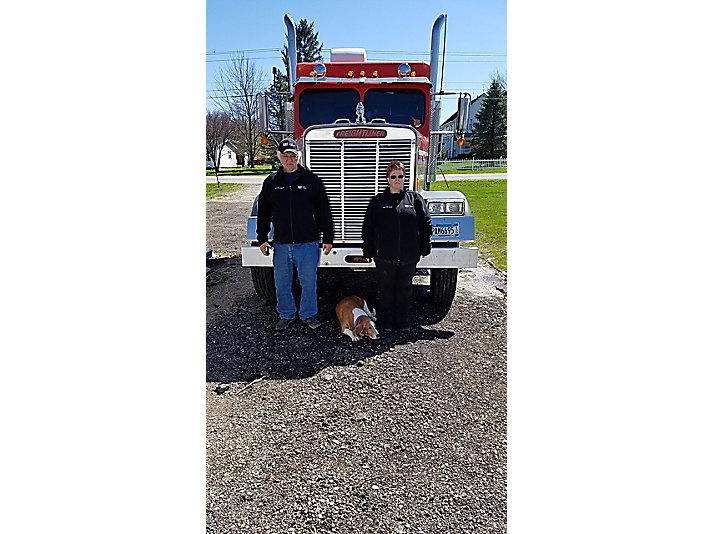 3-Million-Miler Jerry Scheidt at his home base in Marengo, Ohio, with his wife, Bonnie Scheidt, and basset hound, Buster.