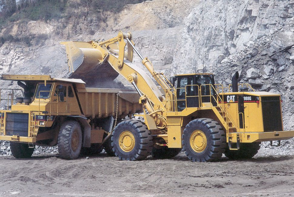The 988G Wheel Loader was produced in late 2000.  Rated at 9.2 yards, it was equipped with mono boom design like that found on the 992G.