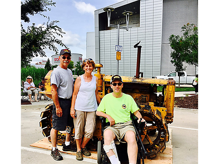 Kevin, Jerry and Marla Jarboe with their 1952 Caterpillar D2 tractor.