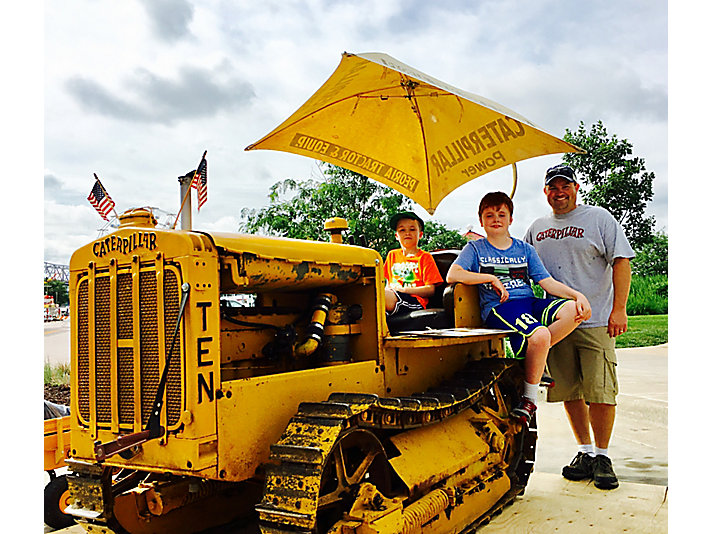 Dave, Nick and Levi Tallon with their 1929 Caterpillar Ten tractor.