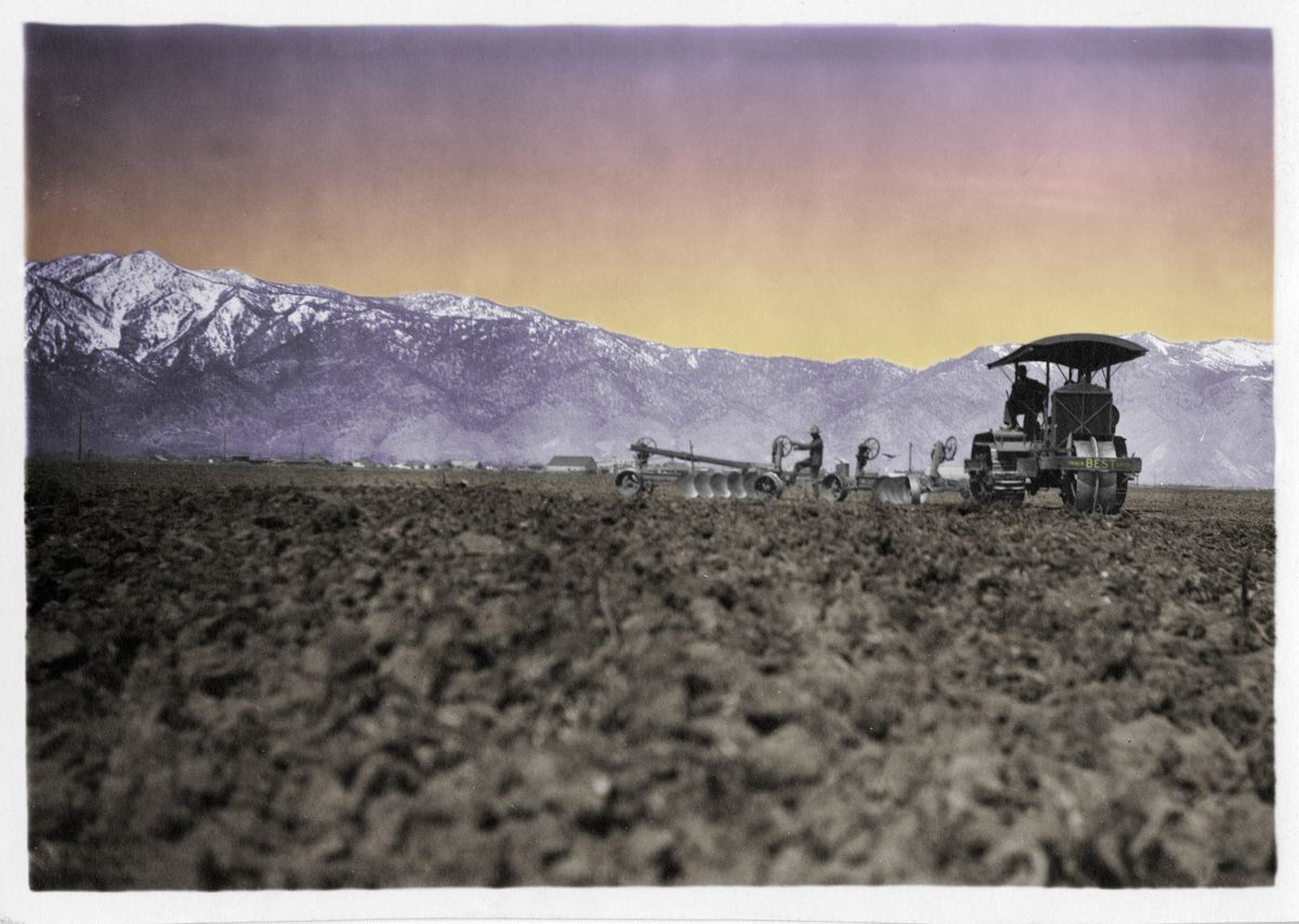 Colorized image of Best 75 working near a mountain range.