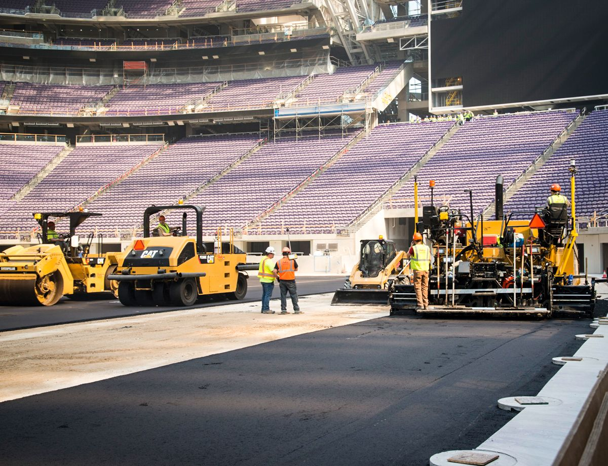 The team met the challenge of paving a stadium bowl that is oval-shaped, and includes concrete drainage and other details like conduit for end zone cameras.