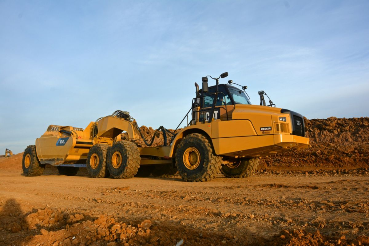 The MTS Articulated Truck and Scraper Pull Pan Combinations being used on the Southwest Arterial are Cat 745C Articulated Trucks that utilize an MTS conversion package for scraper use, and are easily converted back for truck applications.