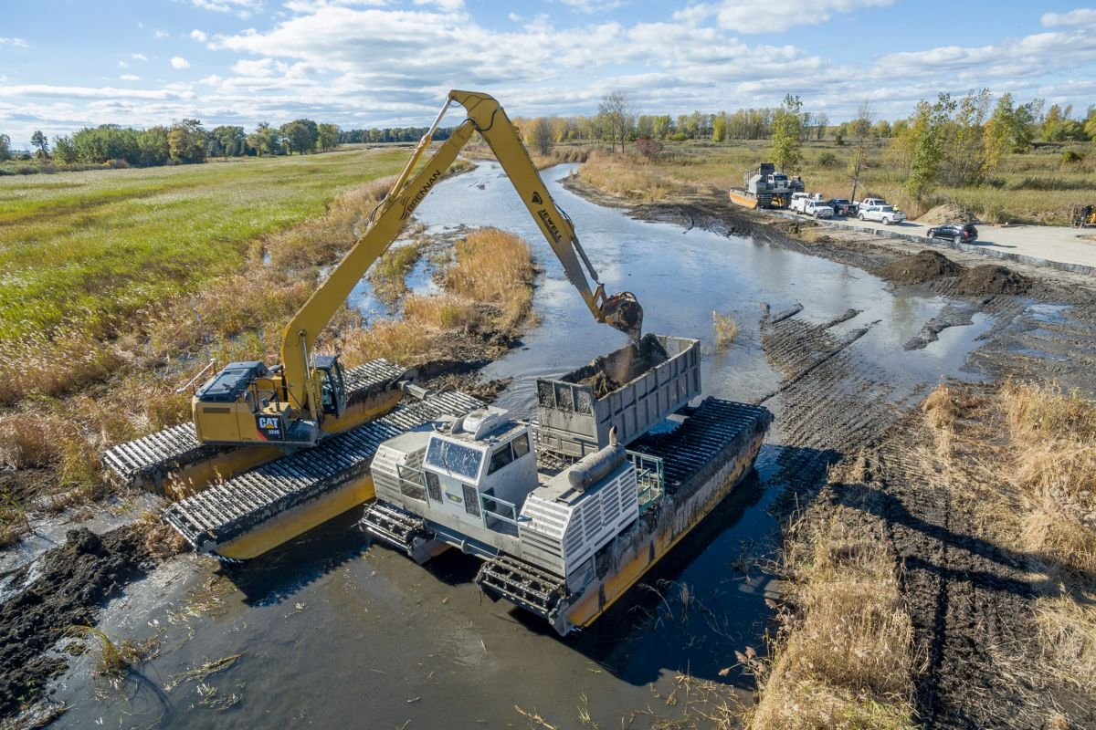 Amphibious excavators enabled the J.F. Brennan Company crew to work with minimum disturbance in areas that were simply too soupy for conventional machines.