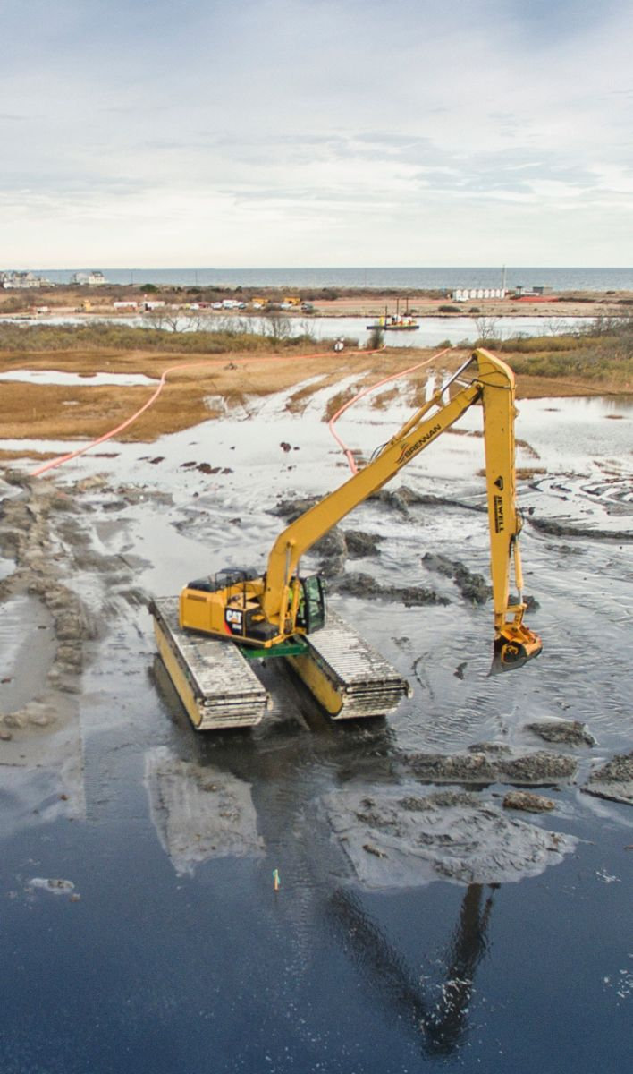 DREDGING AT NINIGRET POND OPENS WATERWAYS AND IMPROVES THE ENVIRONMENT