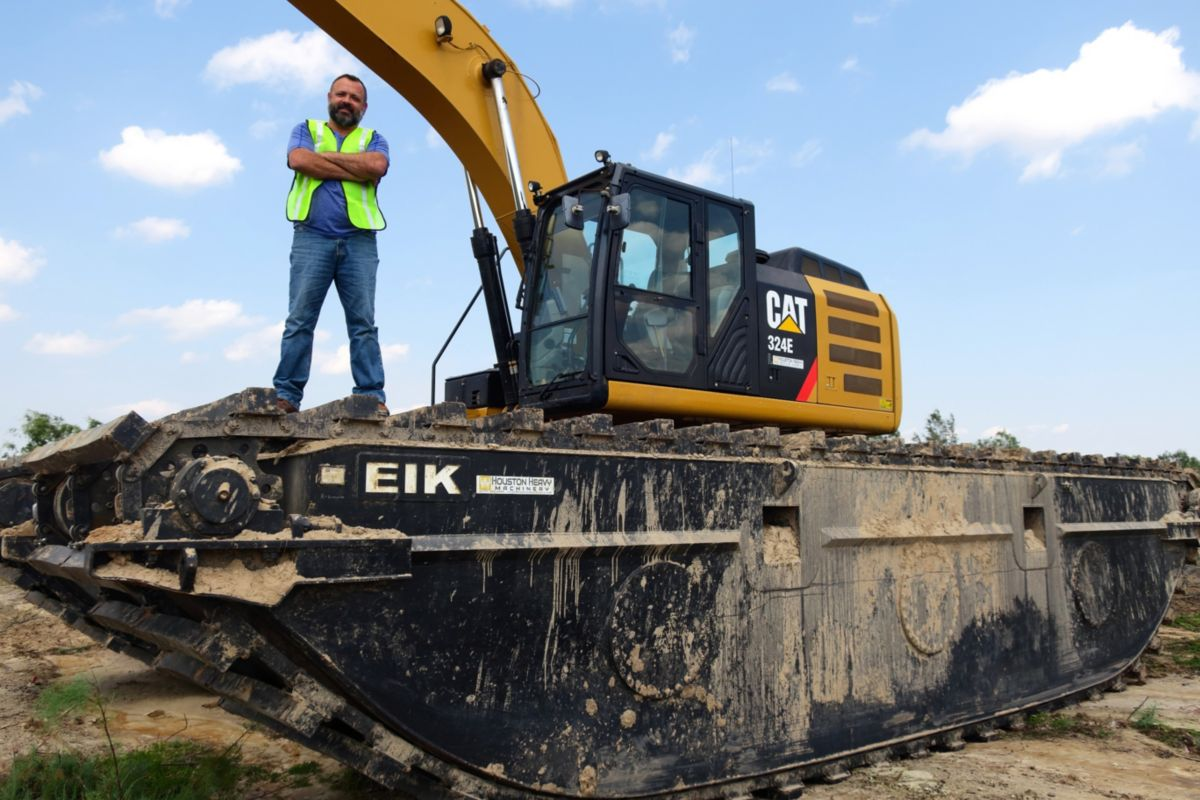 Steve with the Cat® 324E with an EIK AM250 amphibious undercarriage at one of the DAMP sites near the Houston Ship Channel.