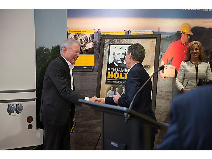 Caterpillar CEO Jim Umpleby thanking and honoring Peter Holt, great-grandson of Benjamin Holt.