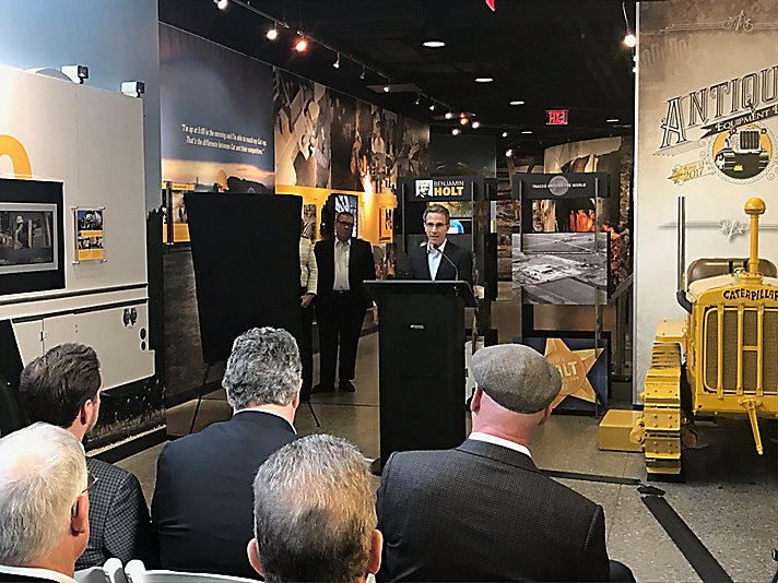 Caterpillar CEO Jim Umpley hosting the exhibit unveiling on November 29, 2017.