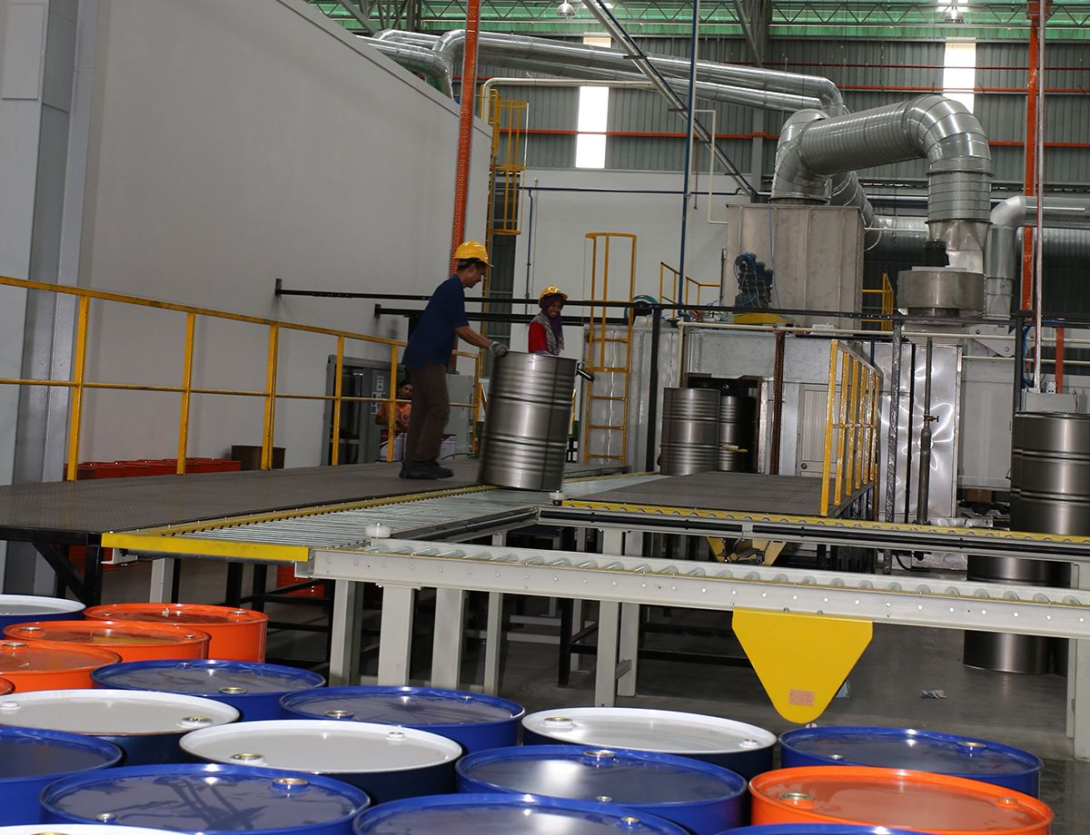 The facility manufactures more than 150,000 barrels a month.