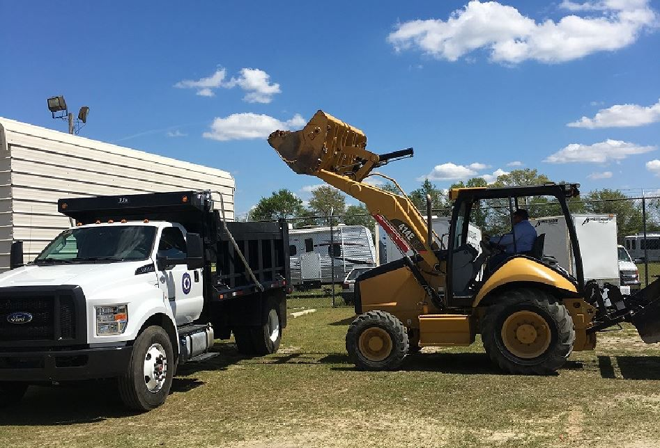 Robeson County Officials report that the Cat® 414E has been essential for not only clearing debris, but also repairing a myriad of water lines that were damaged during the storm.