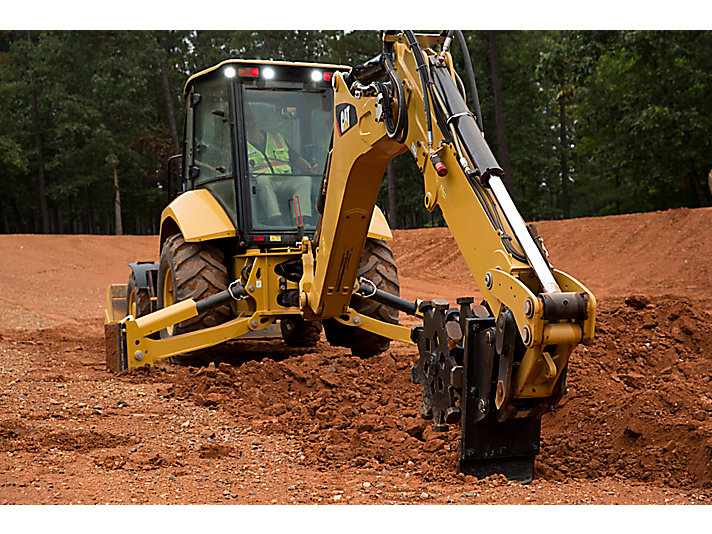 Using backfill plate on Cat® Compaction Wheel to smooth trench bottom