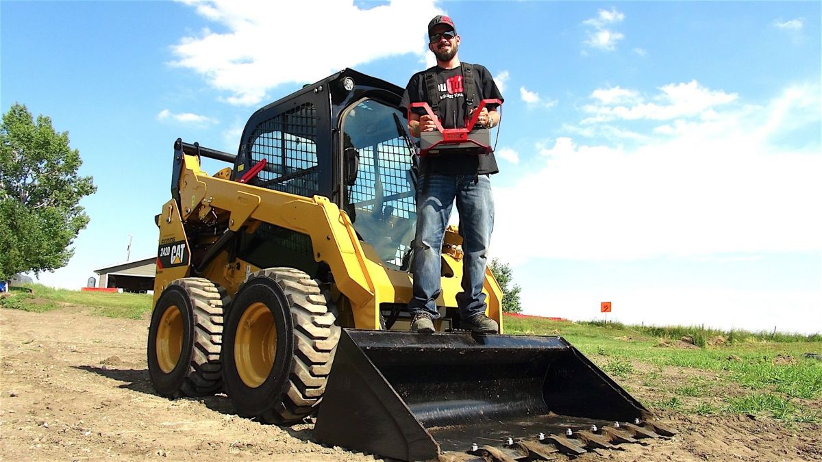 Aaron Bidochka, creator of the RC Sparks Studio YouTube channel, shows off his Cat<sup>®</sup> 242D with RemoteTask™ on his ranch outside of Calgary.