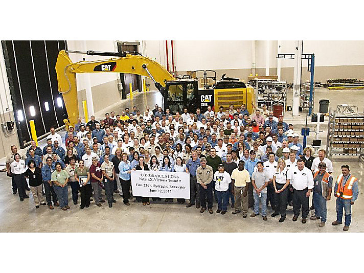 Team Victoria pictured with the first excavator manufactured at the South Texas facility in June 2012.