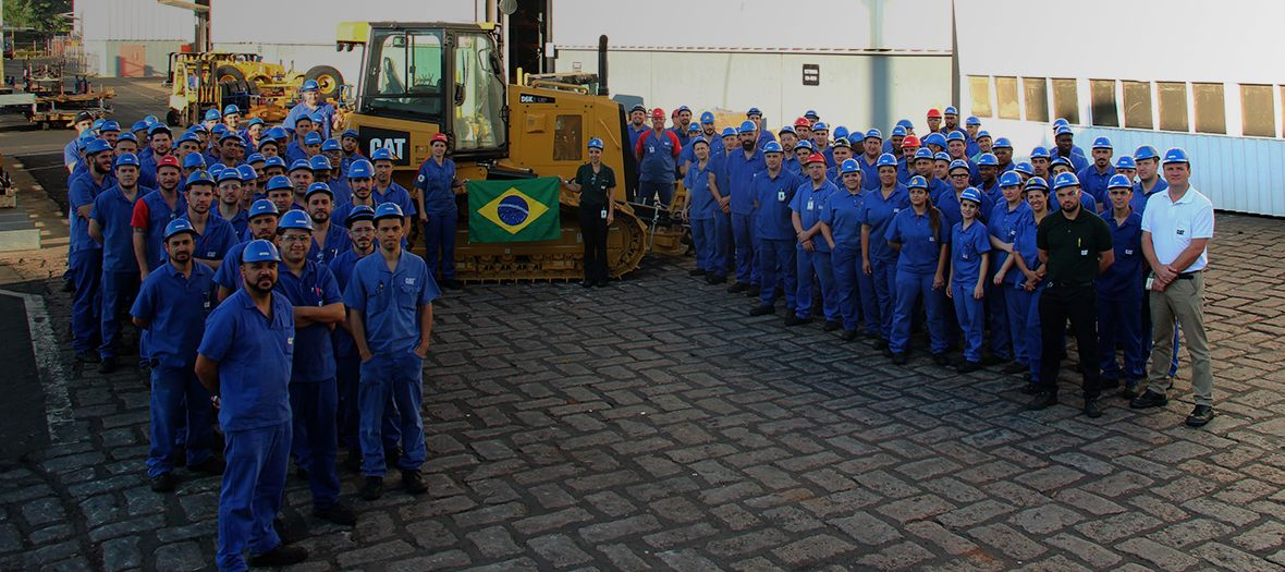 The dozer's assembly line team at Caterpillar Brazil