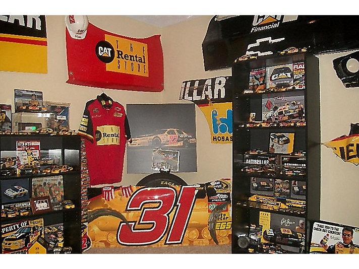 More than 200 of the items he's gathered over the past two decades are on display at the Caterpillar Visitors Center as part of Speed: 26 Years of Cat Racing.