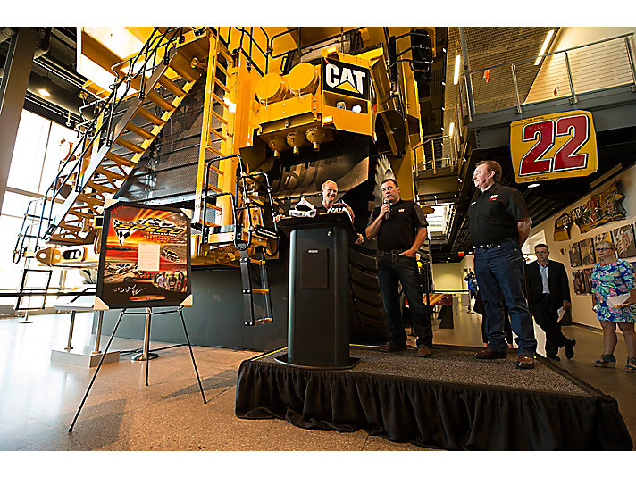 Kory Russell, who loaned more than 200 items from his extensive personal collection to the Caterpillar Visitors Center, took the stage with driver Ryan Newman and team owner Richard Childress