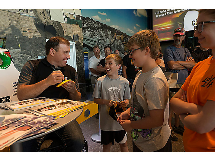 Driver Ryan Newman signed autographs and memorabilia from fans.
