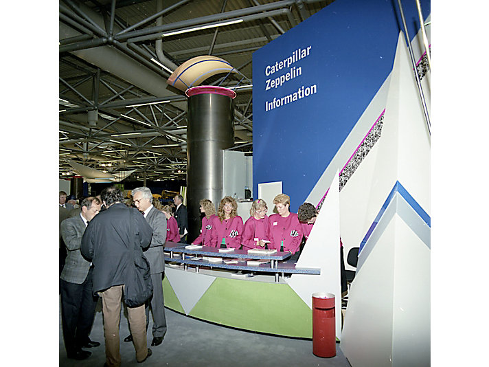 Show workers at the Caterpillar information desk, 1989