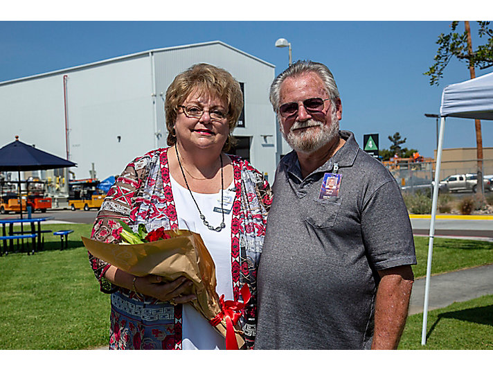 Harry and his wife, Linda. He presented flowers to her during his retirement ceremony.