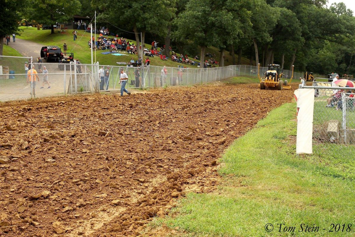 With fans already in place and practice nearing, the track surface starts to take shape.