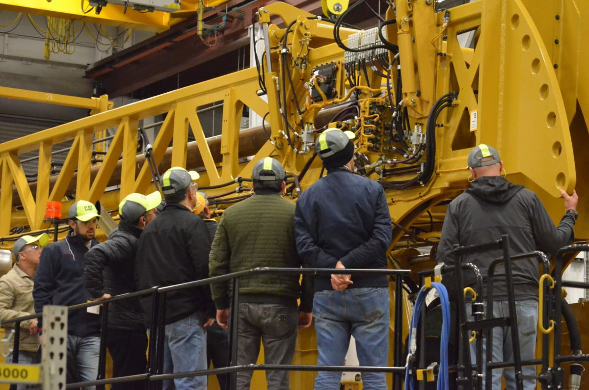 Attendees view the Cat MD6200 Rotary Blasthole Drill Rig Up Close