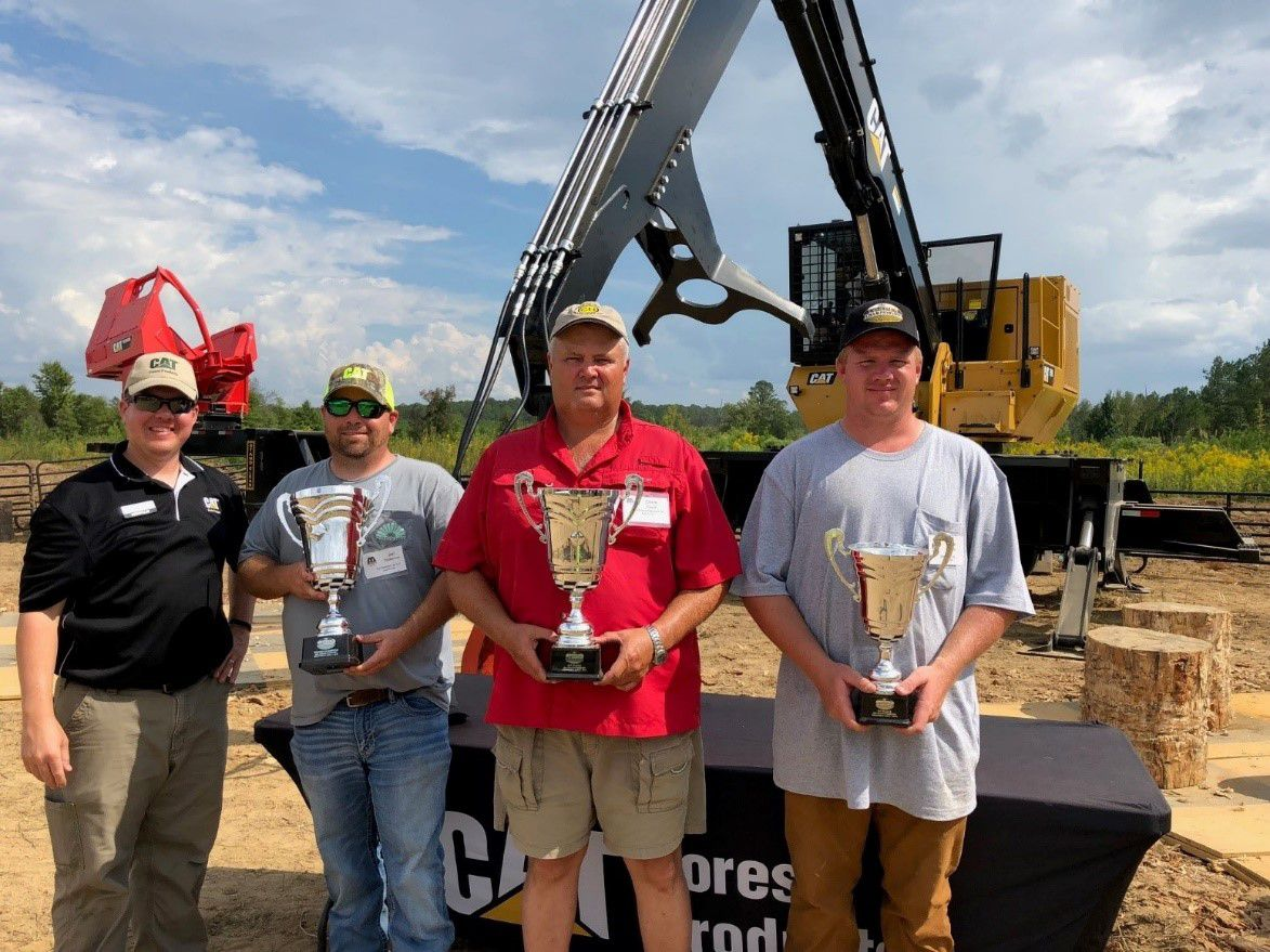 Top three winners in the Loader Championship sponsored by Caterpillar Forest Products