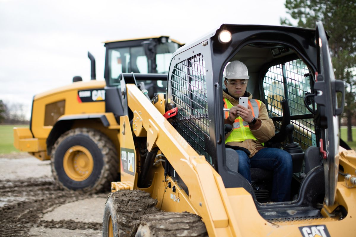 Mobile phone with skid steer and wheel loader