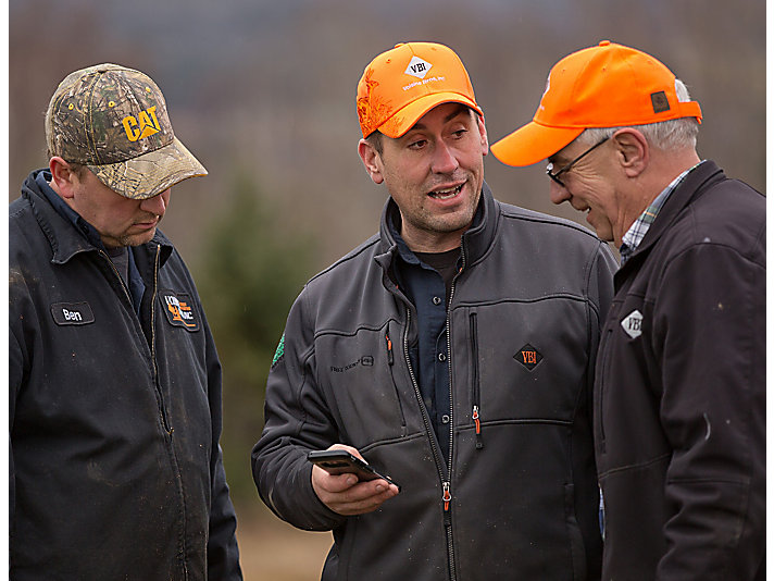 Voisine Brothers Inc. is prominent throughout Northern Maine. Ben (left) and Joe (middle), along with their dad, Gary (right), have operated an award-winning logging business for decades.