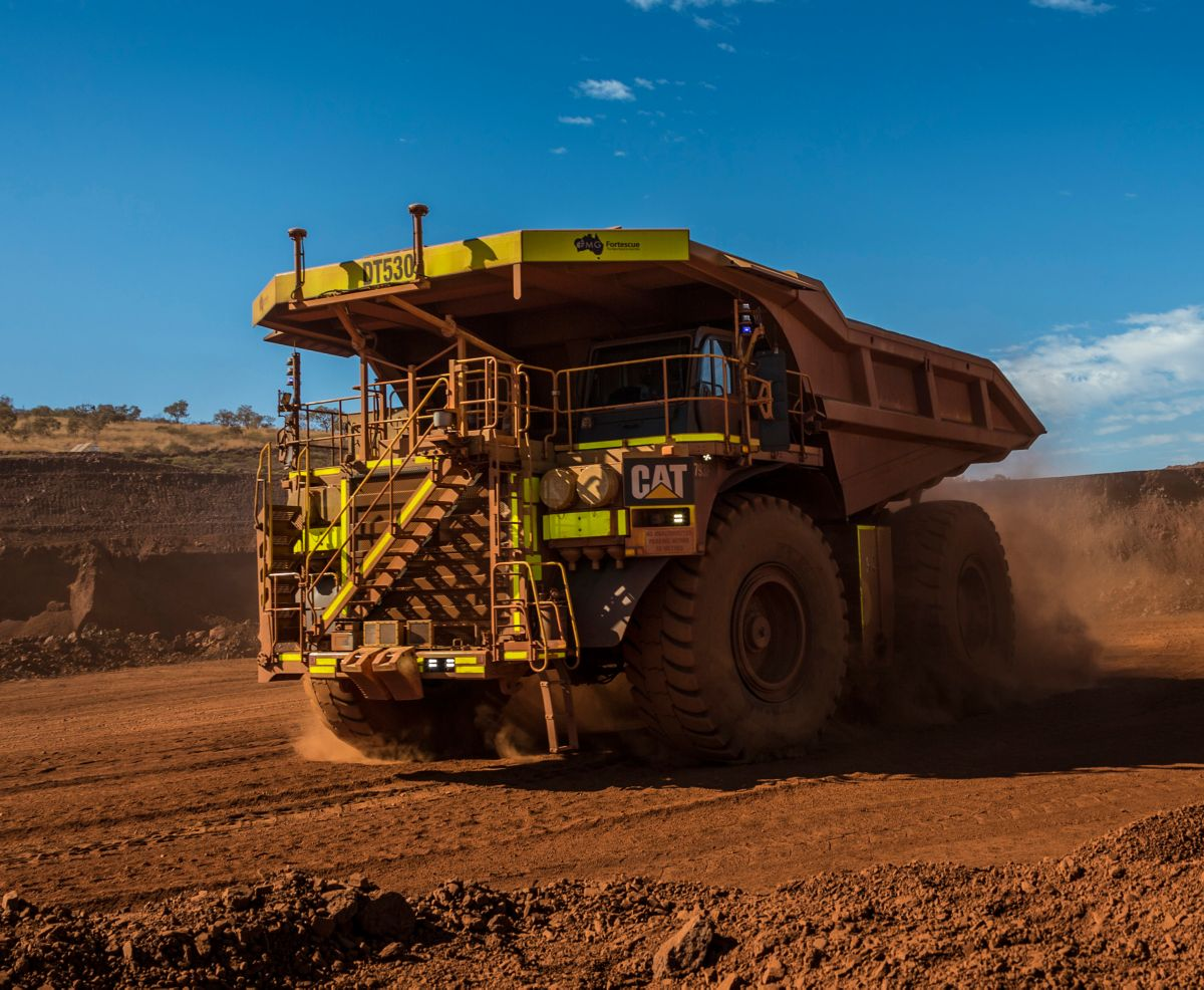 Cat 793F CMD Mining Truck leaving iron ore pit